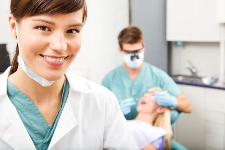 How is a dental crown fitted?